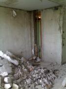 Dismantling santehkabiny,partitions.Cutting,widening of doorways